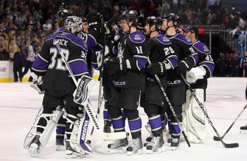 LOS ANGELES, CA - JANUARY 26:  Jonathan Quick #32 of the Los Angeles Kings celebrates with teammate Anze Kopitar #11 after defeating the San Jose Sharks 3-2 in shootout overtime at Staples Center on January 26, 2011 in Los Angeles, California.  (Photo by