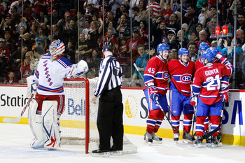 MONTREAL, CANADA - FEBRUARY 5:  Members of the Montreal Canadiens celebrate the second period goal by team mate Scott Gomez #11 during the NHL game against the New York Rangers at the Bell Centre on February 5, 2011 in Montreal, Quebec, Canada.  (Photo by