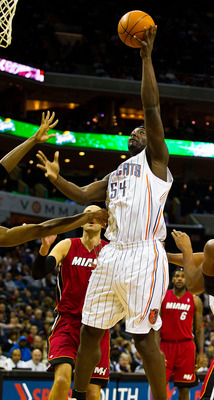 CHARLOTTE, NC - JANUARY 03: Kwame Brown #54 takes a shot against the Miami Heat at Time Warner Cable Arena on January 3, 2011 in Charlotte, North Carolina.  The Heat defeated the Bobcats 96-82.  (Photo by Brian A. Westerholt/Getty Images)