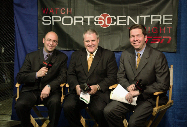 EAST RUTHERFORD, NJ - JUNE 9:  TSN reporters (L-R) Pierre McGuire, Bob McKenzie and Gord Miller during game seven of the 2003 Stanley Cup Finals between the New Jersey Devils and the Mighty Ducks of Anaheim at Continental Airlines Arena on June 9, 2003 in