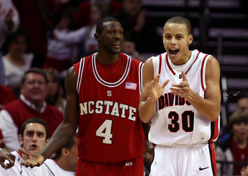 CHARLOTTE, NC - DECEMBER 06:  Stephen Curry #30 of the Davidson Wildcats reacts to a call with Courtney Fells #4 of the North Carolina State Wolfpack during their game at Time Warner Cable Arena on December 6, 2008 in Charlotte, North Carolina.  (Photo by