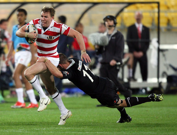WELLINGTON, NEW ZEALAND - OCTOBER 23: Michael Shenton of England is tackled by Simon Mannering of the Kiwis during the Four Nations match between the New Zealand Kiwis and England at Westpac Stadium on October 23, 2010 in Wellington, New Zealand.  (Photo