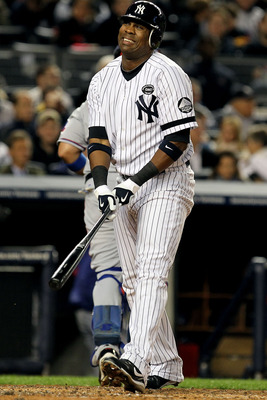 NEW YORK - OCTOBER 18:  Marcus Thames #38 of the New York Yankees reacts after he stuck out in the bottom of the second inning against the Texas Rangers in Game Three of the ALCS during the 2010 MLB Playoffs at Yankee Stadium on October 18, 2010 in New Yo