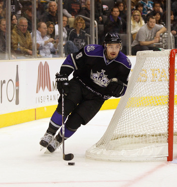 LOS ANGELES, CA - JANUARY 26:  Drew Doughty #8 of the Los Angeles Kings plays the puck around the net so start the breakout play from the Kings zone against the San Jose Sharks during their NHL game at Staples Center on January 26, 2011 in Los Angeles, Ca