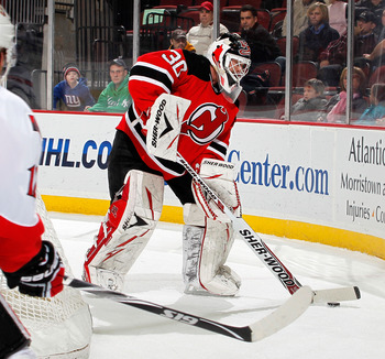 NEWARK, NJ - FEBRUARY 01:  Goalie Martin Brodeur #30 of the New Jersey Devils plays the puck behind the net during an NHL hockey game against the Ottawa Senators at the Prudential Center on February 1, 2011 in Newark, New Jersey.  (Photo by Paul Bereswill