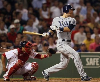 BOSTON - SEPTEMBER 07:  Ben Zobrist #18 of the Tampa Bay Rays hits a two run homer in the third inning as Victor Martinez #41 of the Boston Red Sox  defends on September 7, 2010 at Fenway Park in Boston, Massachusetts.  (Photo by Elsa/Getty Images)