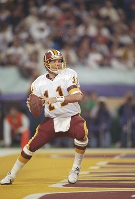 26 Jan 1992:  Quarterback Mark Rypien of the Washington Redskins looks to pass the ball during Super Bowl XXVI against the Buffalo Bills at the Hubert H. Humphrey Metrodome in Minneapolis, Minnesota.  The Reskins won the game, 37-24.  Rypien was named the