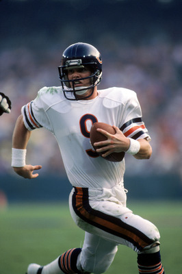 ANAHEIM, CA - NOVEMBER 6:  Quarterback Jim McMahon #9 of the Chicago Bears runs with the ball during a game against the Los Angeles Rams at Anaheim Stadium on November 6, 1983 in Anaheim, California.   The Rams won 21-14.  (Photo by George Rose/Getty Imag