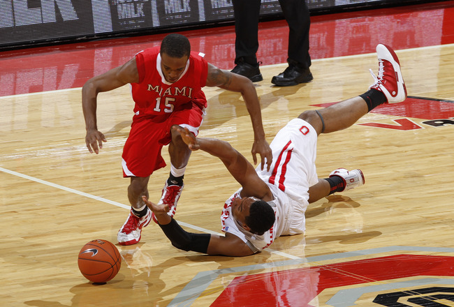 COLUMBUS, OH - NOVEMBER 26: Jared Sullinger #0 of the Ohio State Buckeyes knocks the ball away from Orlando Williams #15 of the Miami RedHawks at Value City Arena on November 26, 2010 in Columbus, Ohio. Ohio State won 66-45. (Photo by Joe Robbins/Getty Im