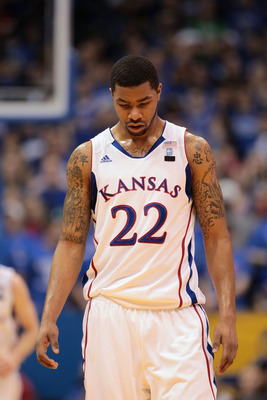 LAWRENCE, KS - JANUARY 22:  Marcus Morris #22 of the Kansas Jayhawks walks off the court during a timeout during the game against the Texas Longhorns on January 22, 2011 at Allen Fieldhouse in Lawrence, Kansas.  (Photo by Jamie Squire/Getty Images)