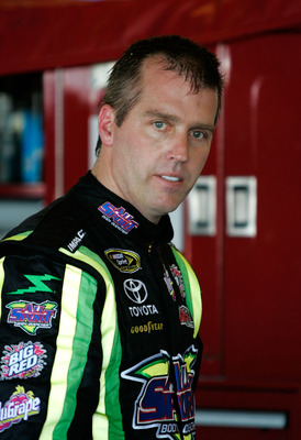 TALLADEGA, AL - APRIL 24:  Jeremy Mayfield, driver of the #41 All Sport Body Quencher Toyota, waits in the garage area during practice for the NASCAR Sprint Cup Series Aaron's 499 at Talladega Superspeedway on April 24, 2009 in Talladega, Alabama.  (Photo