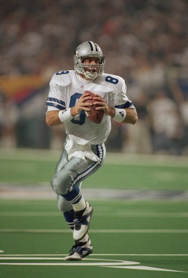 ATLANTA, GA - JANUARY 30:  Quarterback Troy Aikman #8 of the Dallas Cowboys rolls out to his right during Super Bowl XXVIII on January 30, 1994 against the Buffalo Bills at the Georgia Dome in Atlanta, Georgia.  The Cowboys defeated the Bills 30-13.  (Pho