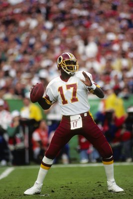 SAN DIEGO - JANUARY 31:  Quarterback Doug Williams #10 of the Washington Redskins drops back to pass during Super Bowl XXII against the Denver Broncos at Jack Murphy Stadium on January 31, 1988 in San Diego, California.  The Redskins won 42-10.  (Photo by