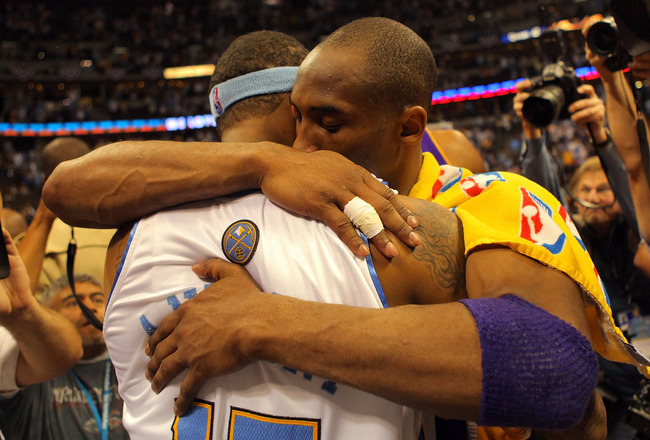 DENVER - MAY 29:  Kobe Bryant #24 of the Los Angeles Lakers hugs Carmelo Anthony #15 of the Denver Nuggets after the Lakers defeated the Nuggets 119-92 in Game Six of the Western Conference Finals during the 2009 NBA Playoffs at Pepsi Center on May 29, 20