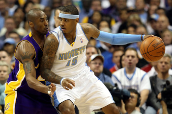DENVER - MAY 25:  Carmelo Anthony #15 of the Denver Nuggets posts up Kobe Bryant #24 of the Los Angeles Lakers in the first quarter of Game Four of the Western Conference Finals during the 2009 NBA Playoffs at Pepsi Center on May 25, 2009 in Denver, Color