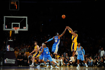 LOS ANGELES, CA - MAY 19:  Kobe Bryant #24 of the Los Angeles Lakers shoots a jumper over Carmelo Anthony #15 of the Denver Nuggets in the fourth quarter of Game One of the Western Conference Finals during the 2009 NBA Playoffs at Staples Center on May 19