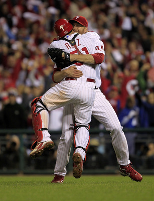Roy Halladay (34) hugs his catcher Carlos Ruiz (51) after tossing a no hitter in the NLDS