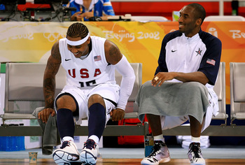 BEIJING - AUGUST 18:  Carmelo Anthony #15 and Kobe Bryant #10 of the United States share a laugh on the bench during the men?s basketball preliminaries against Germany at the Wukesong Indoor Stadium on Day 10 of the Beijing 2008 Olympic Games on August 18