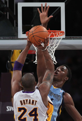 LOS ANGELES, CA - JANUARY 02:  Hasheem Thabeet #34 of the Memphis Grizzlies goes up to block a shot by Kobe Bryant #24 of the Los Angeles Lakers during the first half at Staples Center on January 2, 2011 in Los Angeles, California. The Grizzlies defeated