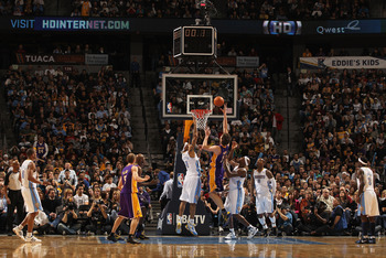 DENVER, CO - JANUARY 21:  Pau Gasol #16 of the Los Angeles Lakers puts up a shot between Kenyon Martin #4 and Al Harrington #7 of the Denver Nuggets at the Pepsi Center on January 21, 2011 in Denver, Colorado. The Lakers defeated the Nuggets 107-97. NOTE
