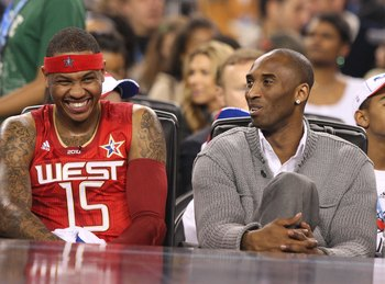 ARLINGTON, TX - FEBRUARY 14:  An injured Kobe Bryant sits on on the bench with Carmelo Anthony #15 of the Western All-Stars during the the NBA All-Star Game, part of 2010 NBA All-Star Weekend at Cowboys Stadium on February 14, 2010 in Arlington, Texas. NO