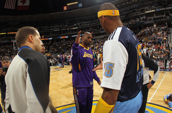 DENVER - NOVEMBER 11:  Carmelo Anthony #15 of the Denver Nuggets and Kobe Bryant #24 of the Los Angeles Lakers meet at mid court prior to the game at the Pepsi Center on November 11, 2010 in Denver, Colorado. The Nuggets defeated the Lakers 118-112.  NOTE
