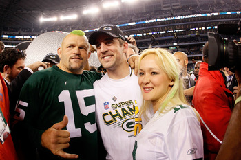 ARLINGTON, TX - FEBRUARY 06: Former MMA Champion Chuck Liddell, Super Bowl MVP Aaron Rodgers #12 of the Green Bay Packers and Heidi Northcott celebrate after the Packers winning Super Bowl XLV 31-25 against the Pittsburgh Steelers at Cowboys Stadium on Fe