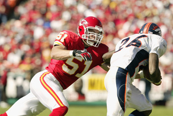 KANSAS CITY, MO-OCTOBER 20:  Linebacker Scott Fujita #51 of the Kansas City Chiefs attempts to tackle Running back Clinton Portis #26 of the Denver Broncos as he rushes for yards against the Chieft during the NFL game on October 20, 2002 at Arrowhead Stad