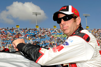 HOMESTEAD, FL - NOVEMBER 21:  Greg Biffle, driver of the #16 3M Ford, stands by his car prior to the NASCAR Sprint Cup Series Ford 400 at Homestead-Miami Speedway on November 21, 2010 in Homestead, Florida.  (Photo by John Harrelson/Getty Images for NASCA