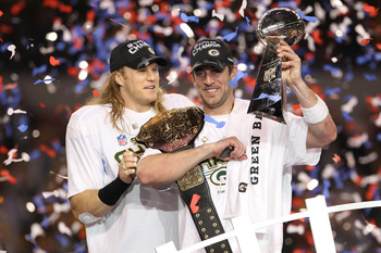 ARLINGTON, TX - FEBRUARY 06:  Aaron Rodgers #12 and Clay Matthews #52 of the Green Bay Packers of the Green Bay Packers holds the Lombardi Trophy after defeating the Pittsburgh Steelers 31-25 during Super Bowl XLV at Cowboys Stadium on February 6, 2011 in