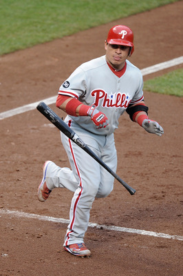 SAN FRANCISCO - OCTOBER 21:  Carlos Ruiz #51 of the Philadelphia Phillies throws his bat after being hit by a Tim Lincecum #55 of the San Francisco Giants pitch in the third inning in Game Five of the NLCS during the 2010 MLB Playoffs at AT&T Park on Octo
