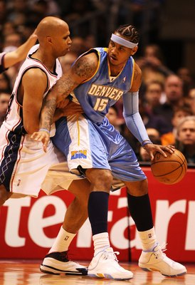 EAST RUTHERFORD, NJ - MARCH 21:  Carmelo Anthony #15 of the Denver Nuggets dribbles against Richard Jefferson #24 of the New Jersey Nets during their game on March 21, 2008 at the Izod Arena in East Rutherford, New Jersey.  Photo By Al Bello/Getty Images.