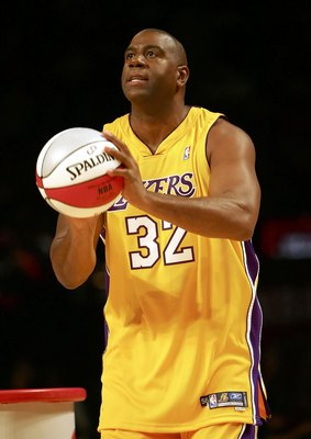 HOUSTON - FEBRUARY 18:  Magic Johnson of the Los Angeles team gets ready to shoot in the Radio Shack Shooting Stars competition during NBA All-Star Weekend at the Toyota Center on February 18, 2006 in Houston, Texas.  NOTE TO USER: User expressly acknowle