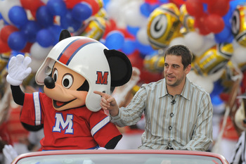 LAKE BUENA VISTA, FL - FEBRUARY 07:  In this handout photo provided by Disney, Super Bowl XLV Most Valuable Player Aaron Rodgers takes a celebratory ride with Mickey Mouse, following the Green Bay Packers' 31-25 victory over the Pittsburgh Steelers Februa