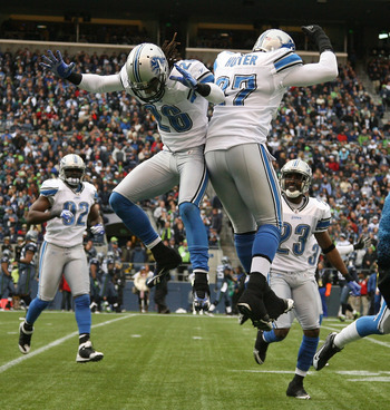 SEATTLE - NOVEMBER 08:  Safety Louis Delmas #26 of the Detroit Lions celebrates with Jason Hunter #97 after making an interception against the Seattle Seahawks on November 8, 2009 at Qwest Field in Seattle, Washington. (Photo by Otto Greule Jr/Getty Image