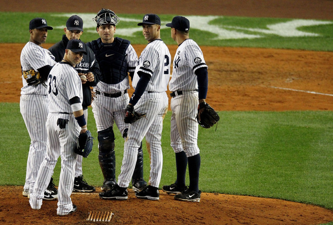 NEW YORK - OCTOBER 19:  Manager Joe Girardi, Nick Swisher #33, Robinson Cano #24, Derek Jeter #2 and Alex Rodriguez #13 of the New York Yankees stand on the mound during a pitching change against the Texas Rangers in Game Four of the ALCS during the 2010