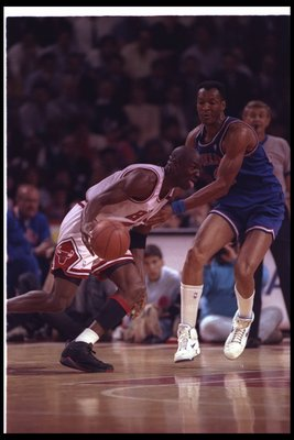 19 May 1992:  Guard Michael Jordan of the Chicago Bulls (left) moves the ball during a game against the Cleveland Cavaliers at the United Center in Chicago, Illinois. Mandatory Credit: Jonathan Daniel  /Allsport