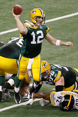 ARLINGTON, TX - FEBRUARY 06:  Aaron Rodgers #12 of the Green Bay Packers drops back against the Pittsburgh Steelers in the second quarter of Super Bowl XLV at Cowboys Stadium on February 6, 2011 in Arlington, Texas.  (Photo by Joe Robbins/Getty Images)