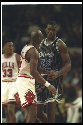 1992-1993:  Center Shaquille O''Neal of the Orlando Magic (right) confers with guard Michael Jordan of the Chicago Bulls during a game at the United Center in Chicago, Illinois. Mandatory Credit: Jonathan Daniel  /Allsport Mandatory Credit: Jonathan Danie