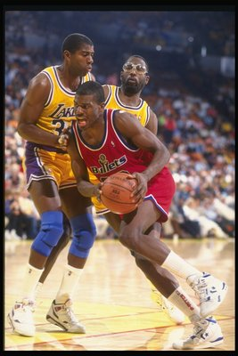 8 Dec 1990:  Forward Bernard King of the Washington Bullets (center) drives the ball past guard Magic Johnson (left) and forward James Worthy of the Los Angeles Lakers during a game at the Great Western Forum in Inglewood, California. Mandatory Credit: Ke