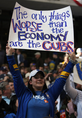 MILWAUKEE - APRIL 10: A fan of the Milwaukee Brewers holds a sign during the Opening Day game against Chicago Cubs during the Opening Day game on April 10, 2009 at Miller Park in Milwaukee, Wisconsin. (Photo byJonathan Daniel/Getty Images)