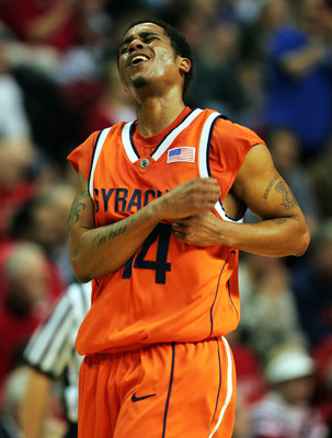 PISCATAWAY, NJ - JANUARY 24:  Billy Edelin #14 of the Syracuse Orangemen shows his emotion after being called for his third foul against the Rutgers Scarlet Knights January 24, 2005 at the RAC in Piscataway, New Jersey.  (Photo by Ezra Shaw/Getty Images)
