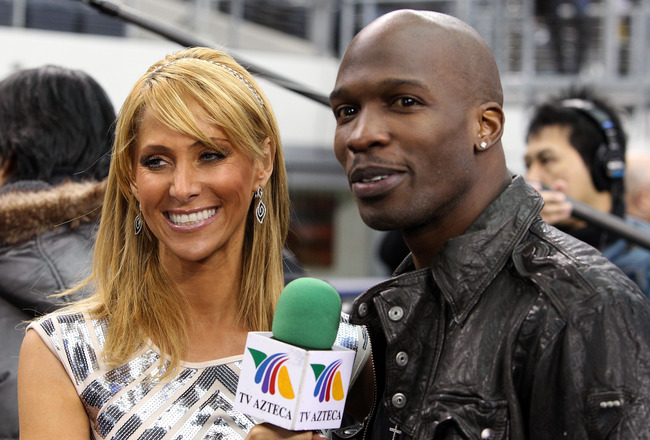 ARLINGTON, TX - FEBRUARY 01:  NFL player Chad Johnson is interviewed by TV personality Inez Sainz on the field during Super Bowl XLV Media Day ahead of Super Bowl XLV at Cowboys Stadium on February 1, 2011 in Arlington, Texas. The Pittsburgh Steelers will