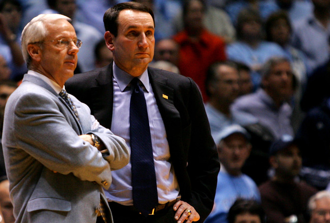 CHAPEL HILL, NC - MARCH 04:  Head coach Mike Krzyzewski (R) of the Duke Blue Devils waits on the officials with head coach Roy Williams of the University of North Carolina Tar Heels after an incident involving Tyler Hansbrough and Gerald Henderson during