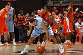CHAMPAIGN, IL - NOVEMBER 30: D.J. Richardson #1 of the Illinois Fighting Illini defends against Kendall Marshall #5 of the North Carolina Tar Heels during first half action of the 2010 ACC/Big Ten Challenge at Assembly Hall on November 30, 2010 in Champai