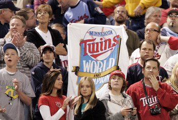 MINNEAPOLIS, MN - OCTOBER 4: A Minnesota Twins fan holds up a sign honoring the 1987 World Series winners during a tribute to the Hubert H. Humphrey Metrodome on October 4, 2009 in Minneapolis, Minnesota. (Photo by Genevieve Ross/Getty Images)