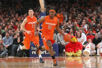 NEW YORK - MARCH 14:  Paul Harris #11 of the Syracuse Orange dribbles the ball downcourt against the Louisville Cardinals during the championship game of the Big East Tournament at Madison Square Garden on March 14, 2009 in New York City.  (Photo by Jim M