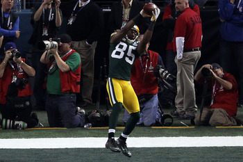ARLINGTON, TX - FEBRUARY 06:  Greg Jennings #85 of the Green Bay Packers catches a a fourth quarter touchdown pass against the Pittsburgh Steelers  during Super Bowl XLV at Cowboys Stadium on February 6, 2011 in Arlington, Texas.  (Photo by Jonathan Danie