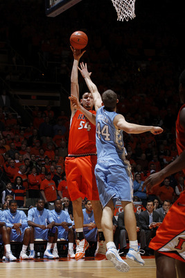 CHAMPAIGN, IL - NOVEMBER 30: Mike Tisdale #54 of the Illinois Fighting Illini takes a shot over Tyler Zeller #44 of the North Carolina Tar Heels during the 2010 ACC/Big Ten Challenge at Assembly Hall on November 30, 2010 in Champaign, Illinois. Illinois d