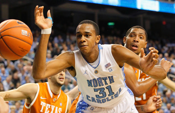 GREENSBORO, NC - DECEMBER 18:  John Henson #31 of the North Carolina Tar Heels has the ball stripped by Gary Johnson #1 of the Texas Longhorns at Greensboro Coliseum on December 18, 2010 in Greensboro, North Carolina.  (Photo by Kevin C. Cox/Getty Images)